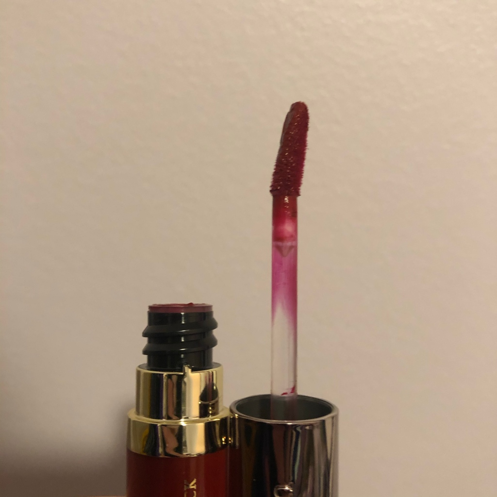 A photo of the Urban Decay Vice Liquid Lipstick in Rocksteady with the tube open revealing the doe foot applicator.